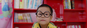 Boy with glasses banner